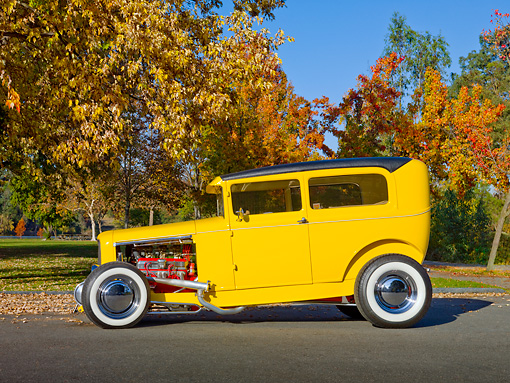 AUT 26 RK2943 01 © Kimball Stock 1931 Ford Sedan Hot Rod Yellow Profile View On Pavement By Trees