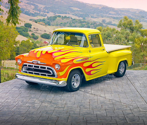 AUT 26 RK2948 01 © Kimball Stock 1957 Chevrolet 3100 Pickup Truck Hot Rod Yellow With Flames 3/4 Front View On Pavement