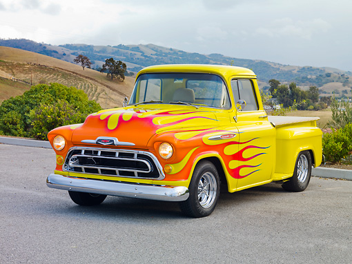 AUT 26 RK2950 01 © Kimball Stock 1957 Chevrolet 3100 Pickup Truck Hot Rod Yellow With Flames 3/4 Front View On Pavement