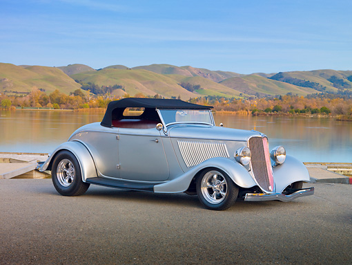 AUT 26 RK2958 01 © Kimball Stock 1933 Ford Roadster Hot Rod Silver 3/4 Front View On Pavement By Lake