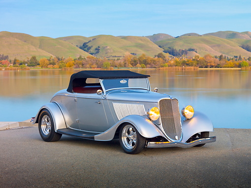 AUT 26 RK2961 01 © Kimball Stock 1933 Ford Roadster Hot Rod Silver 3/4 Front View On Pavement By Lake