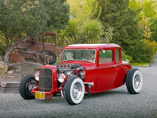 AUT 26 RK3017 01 © Kimball Stock 1932 Ford 5 Window Coupe Red 3/4 Front View On Gravel By Trees