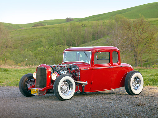 AUT 26 RK3022 01 © Kimball Stock 1932 Ford 5 Window Coupe Red 3/4 Front View On Gravel By Grassy Hills And Trees