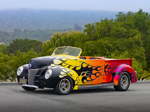 AUT 26 RK3037 01 © Kimball Stock 1939 Ford Pickup Hot Rod Yellow, Orange And Pink With Black Flames 3/4 Front View On Pavement By Trees