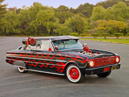 AUT 26 RK3083 01 © Kimball Stock 1963 Ford Falcon Rat Rod Black With Red Graphics 3/4 Side View On Pavement By Trees