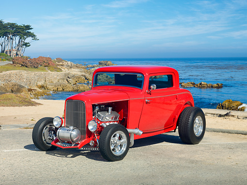AUT 26 RK3110 01 © Kimball Stock 1932 Ford 3 Window Coupe Bright Red 3/4 Front View On Pavement By Beach