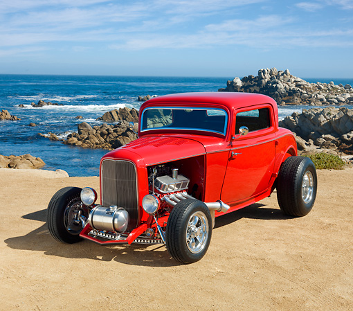 AUT 26 RK3111 01 © Kimball Stock 1932 Ford 3 Window Coupe Bright Red 3/4 Front View On Sand By Ocean