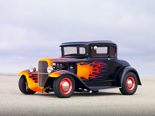 AUT 26 RK3112 01 © Kimball Stock 1931 Ford Model A Black With Orange Flames 3/4 Front View On Pavement In Fog