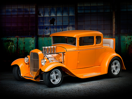 AUT 26 RK3214 01 © Kimball Stock 1930 Ford Model A Hot Rod Orange 3/4 Front View On Pavement By Old Building