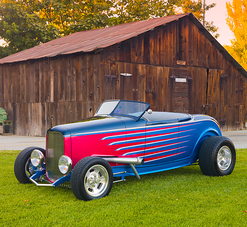 AUT 26 RK3215 01 © Kimball Stock 1932 Ford Roadster Multi-Colored 3/4 Front View On Grass By Old Barn