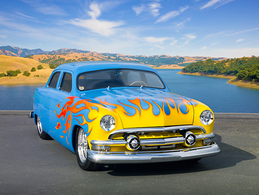 AUT 26 RK3232 01 © Kimball Stock 1951 Ford 4-Door Chopped Sky Blue With Sunset Flames 3/4 Front View On Pavement