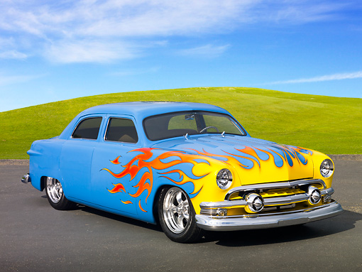 AUT 26 RK3234 01 © Kimball Stock 1951 Ford 4-Door Chopped Sky Blue With Sunset Flames 3/4 Front View On Pavement