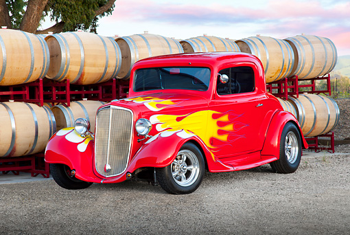 AUT 26 RK3240 01 © Kimball Stock 1934 Chevrolet 3-Window Coupe Red With Flames 3/4 Front View On Gravel By Barrels
