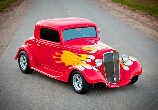 AUT 26 RK3245 01 © Kimball Stock 1934 Chevrolet 3-Window Coupe Red With Flames 3/4 Front View On Road