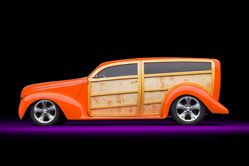 AUT 26 RK3263 01 © Kimball Stock 1939 Ford Woodie Orange Profile View In Studio
