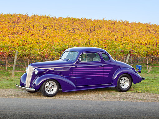 AUT 26 RK3274 01 © Kimball Stock 1937 Chevrolet Coupe Purple 3/4 Side View On Gravel By Vineyard