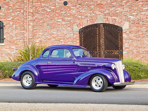AUT 26 RK3277 01 © Kimball Stock 1937 Chevrolet Coupe Purple 3/4 Side View On Pavement By Brick Building