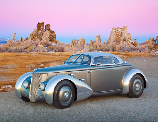 AUT 26 RK3299 01 © Kimball Stock 1936 Ford AeroSport Silver 3/4 Front View On Pavement In Desert At Dusk