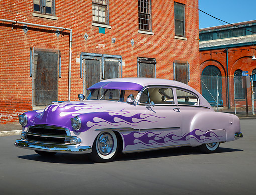 AUT 26 RK3339 01 © Kimball Stock 1951 Chevrolet Fleetline Purple With Flames 3/4 Side View On Pavement By Brick Building