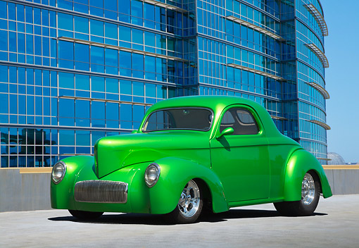 AUT 26 RK3355 01 © Kimball Stock 1941 Willys Coupe Hot Rod Synergin Green 3/4 Front View On Concrete By Glass Building