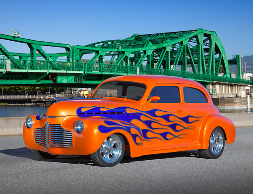 AUT 26 RK3357 01 © Kimball Stock 1941 Chevrolet 2-Door Sedan Orange With Blue Flames 3/4 Front View On Pavement By Bridge