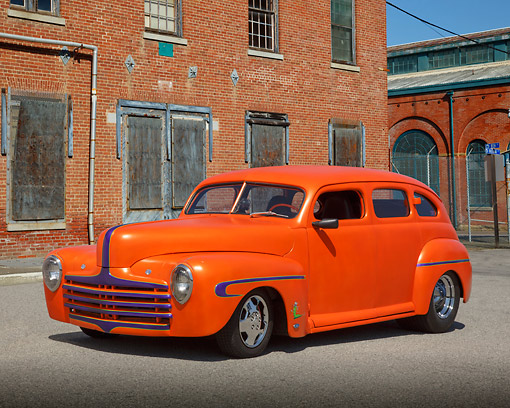 AUT 26 RK3367 01 © Kimball Stock 1946 Ford Sedan Hot Rod Orange 3/4 Front View On Pavement By Brick Building