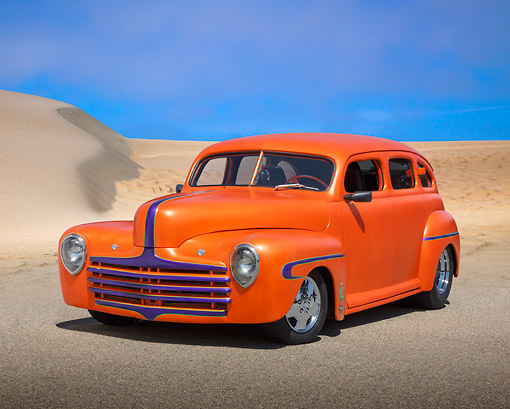 AUT 26 RK3368 01 © Kimball Stock 1946 Ford Sedan Hot Rod Orange 3/4 Front View On Pavement By Sand Dunes
