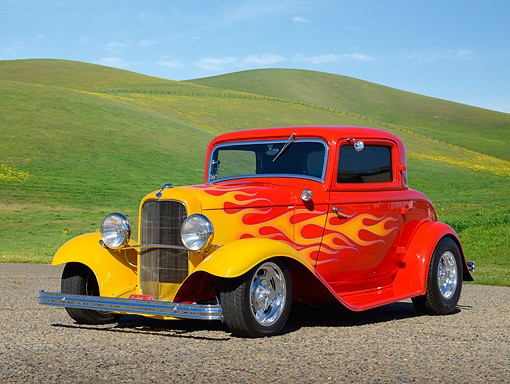 AUT 26 RK3379 01 © Kimball Stock 1932 Ford 3 Window Coupe Red With Flames 3/4 Front View On Gravel By Grassy Hills