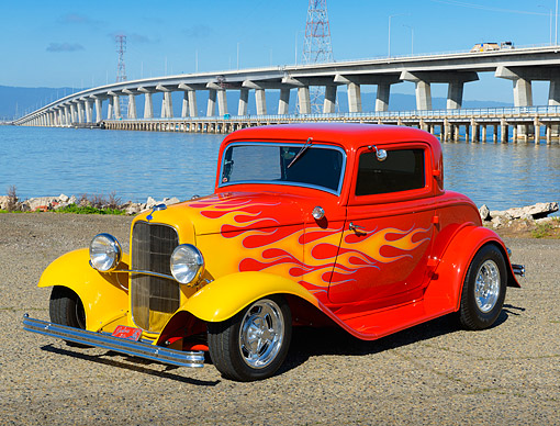 AUT 26 RK3380 01 © Kimball Stock 1932 Ford 3 Window Coupe Red With Flames 3/4 Front View On Gravel By Bridge