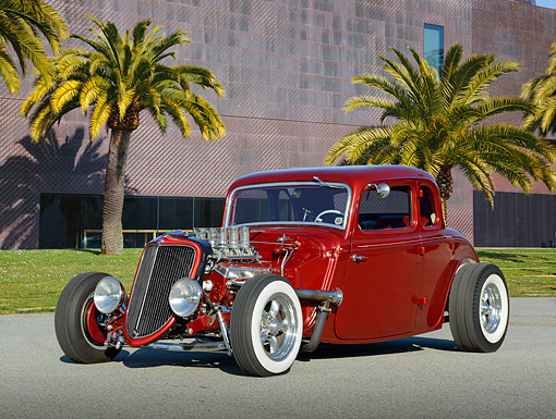 AUT 26 RK3391 01 © Kimball Stock 1933 Ford Model 40 5 Window Burgundy Red 3/4 Front View On Pavement By Building And Palm Trees