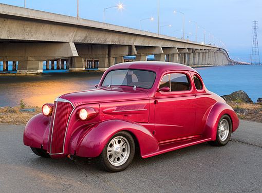 AUT 26 RK3393 01 © Kimball Stock 1937 Chevrolet Coupe Hot Rod Raspberry 3/4 Side View On Pavement By Bridge