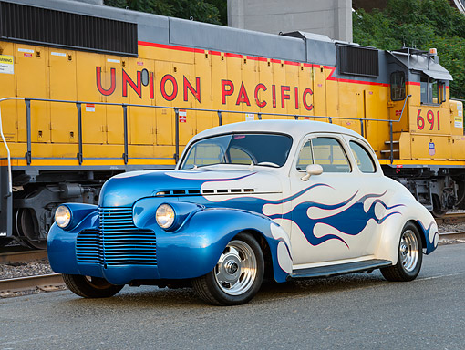 AUT 26 RK3394 01 © Kimball Stock 1940 Chevrolet Coupe Hot Rod White With Blue Flames 3/4 Front View On Pavement By Train