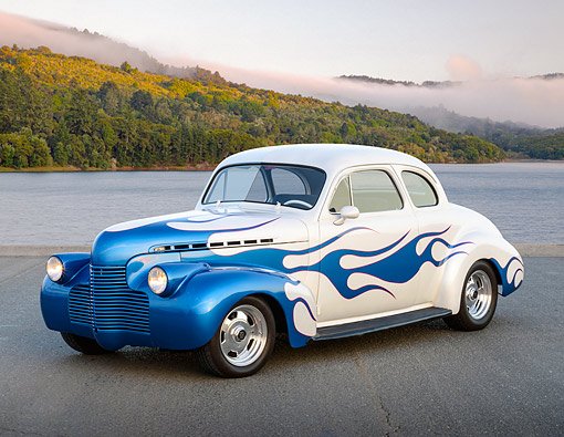 AUT 26 RK3395 01 © Kimball Stock 1940 Chevrolet Coupe Hot Rod White With Blue Flames 3/4 Front View On Pavement By Lake