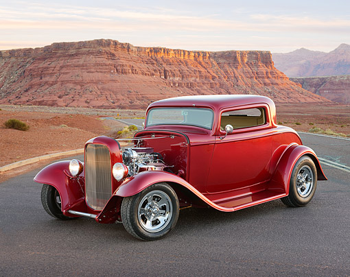 AUT 26 RK3400 01 © Kimball Stock 1932 Ford 3-Window Coupe Red 3/4 Front View On Road In Desert