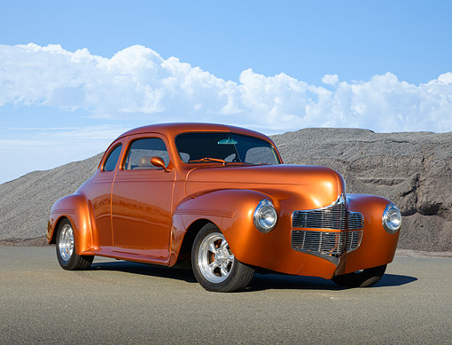 AUT 26 RK3402 01 © Kimball Stock 1940 Dodge Coupe Copperhead 3/4 Front View On Pavement By Rock