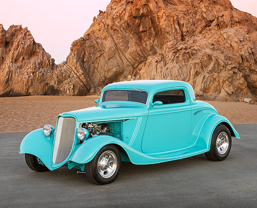 AUT 26 RK3403 01 © Kimball Stock 1934 Ford 3 Window Coupe Aqua 3/4 Front View On Pavement By Sand And Rock