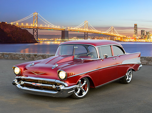 AUT 26 RK3406 01 © Kimball Stock 1957 Chevrolet Bel Air Maroon Candy 3/4 Front View On Pavement By Bay Bridge At Night