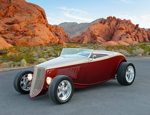 AUT 26 RK3409 01 © Kimball Stock 1933 Ford Cabriolet Hot Rod Burgundy And Bronze 3/4 Front View On Pavement By Red Rock