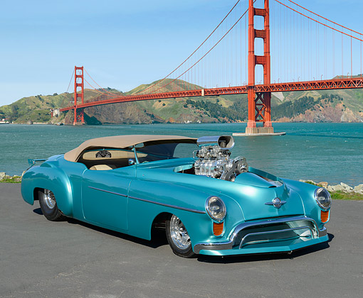 AUT 26 RK3411 01 © Kimball Stock 1948 Oldsmobile Convertible Hot Rod Blue-Green 3/4 Front View On Pavement By Golden Gate Bridge