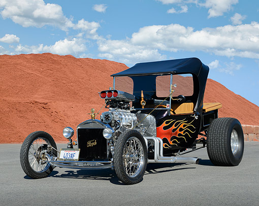 AUT 26 RK3412 01 © Kimball Stock 1923 Ford Model T Hot Rod Black With Flames 3/4 Front View On Pavement By Red Dirt