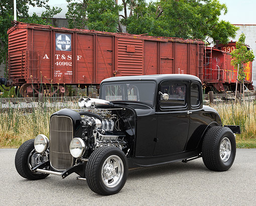 AUT 26 RK3416 01 © Kimball Stock 1932 Ford 5 Window Coupe Black 3/4 Front View On Pavement By Train