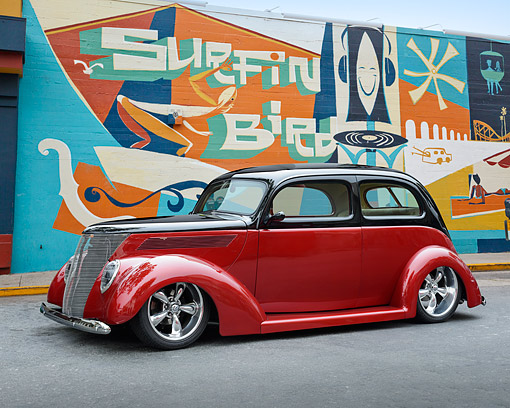 AUT 26 RK3419 01 © Kimball Stock 1937 Ford Tudor Hot Rod Red And Black 3/4 Front View On Pavement By Mural