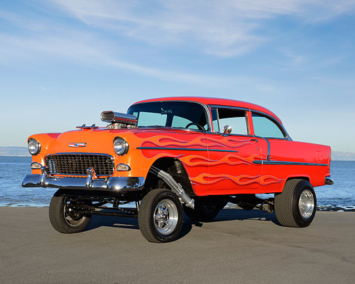 AUT 26 RK3426 01 © Kimball Stock 1955 Chevrolet Gasser Red With Orange Flames 3/4 Front View On Pavement By Bay