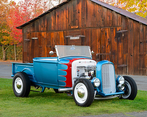 AUT 26 RK3431 01 © Kimball Stock 1930 Ford Pickup Hot Rod Teal 3/4 Front View On Grass By Barn