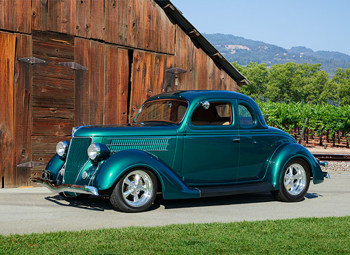 AUT 26 RK3433 01 © Kimball Stock 1936 Ford Hot Rod Green 3/4 Side View On Pavement By Barn