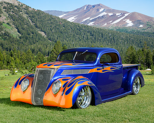 AUT 26 RK3434 01 © Kimball Stock 1937 Ford Truck Hot Rod Blue With Flames 3/4 Front View On Grass By Mountains