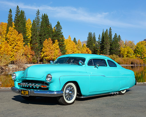 AUT 26 RK3438 01 © Kimball Stock 1951 Mercury Coupe Blue 3/4 Front View On Pavement By Lake