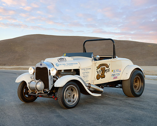 AUT 26 RK3441 01 © Kimball Stock 1929 Ford Model A Roadster Drag Car White 3/4 Front View On Pavement By Hills At Dusk