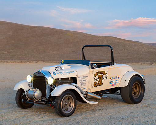 AUT 26 RK3442 01 © Kimball Stock 1929 Ford Model A Roadster Drag Car White 3/4 Front View On Pavement By Hills At Dusk