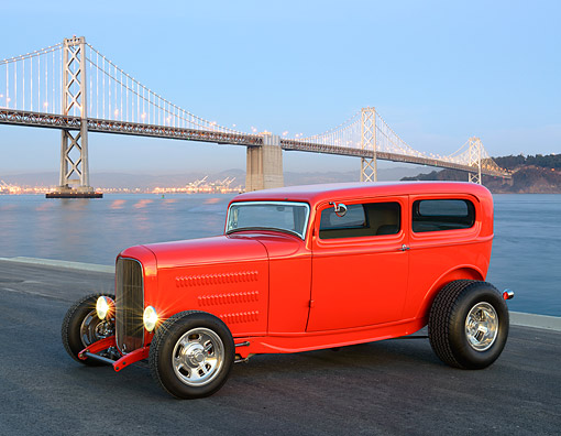 AUT 26 RK3448 01 © Kimball Stock 1932 Ford Tudor Hot Rod Red 3/4 Side View On Pavement By Bay Bridge At Dusk